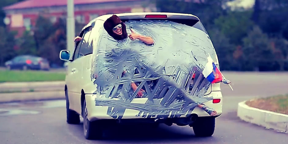 Crazy Russian roads: Ushanka hat, adhesive tape and a car